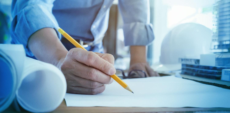 engineer writing on blueprint